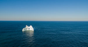 Aerial View Iceberg with a Large Hole, Newfoundland Stock Photo