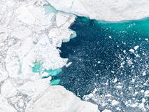 Aerial view of the icebergs on arctic ocean at Greenland Royalty Free Stock Photo