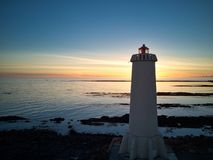 Icelandic Lighthouse at Sunset Stock Images