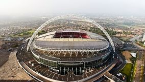 Aerial View of Iconic Landmark Wembley Stadium. Aerial View of Iconic Football and Events Landmark Wembley Stadium, Soccer Arena Flying By Drone Shot in London stock photo