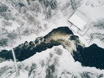 Aerial view of Icy river flowing through a beautiful snowy winter scenery in Oulanka National Park. Finland. Aerial view of Icy river flowing through a Stock Image