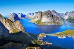 Scandinavia, Norway, Nordic Rugged Landscape, Lofoten Islands. Aerial view - Idyllic Norwegian Fjord with island mountains and Reine fishing village on Lofoten royalty free stock image