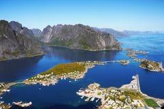 Scandinavia, Norway, Nordic Rugged Landscape, Lofoten Islands. Aerial view - Idyllic Norwegian Fjord with island mountains and Reine fishing village on Lofoten royalty free stock photo