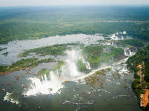 Aerial View Of Iguazzu Falls Landscape. A view from a helicopter down the length of Iguazu Falls from the Devil's Throat end Stock Images