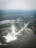 Aerial View Of Iguazzu Falls Portrait. A view from a helicopter down the length of Iguazu Falls from the Devil's Throat end Stock Photo