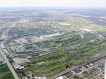 Aerial view of Indianapolis 500, an automobile race held annually at Indianapolis Motor Speedway in Speedway, Indiana through clou. Ds. View from airplane. USA royalty free stock photography