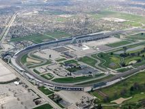 Aerial view of Indianapolis 500, an automobile race held annually at Indianapolis Motor Speedway in Speedway, Indiana through clou. Ds. View from airplane. USA royalty free stock photos