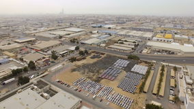 Aerial view industrial area with automotive warehouse, hangars, and buildings on the outskirts of town stock video