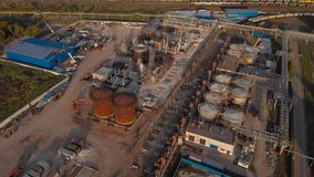 Aerial view. Industrial area with factories and rail freight line. Factories, freight trains and chemical plants. stock footage