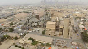 Aerial view industrial area with factories, warehouses, hangars in the outskirts of Dubai stock footage