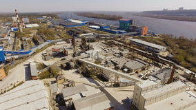 Aerial view industrial area with the plant, factories, warehouses, hangars on the river stock video footage