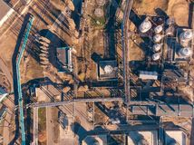Aerial view of industrial factory or plant buildings with steel storage construction tanks and pipes, oil refinery concept royalty free stock photography