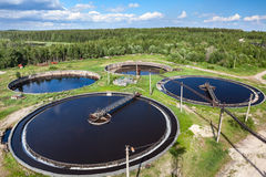 Aerial view of industrial sewage treatment plant. Four round water tanks Stock Photography