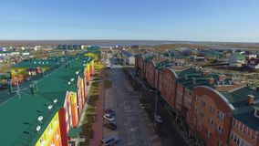 Aerial view of industrial small colorful russian city. The Arctic Circle. 4K stock footage