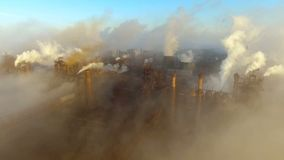 Aerial view. Industrial zone with a large pipes, thick white smoke is poured from the factory pipe. Pollution of the stock video