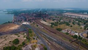 Aerial view of industrial zone and technology park. Mining industry, plants, warehouses stock footage