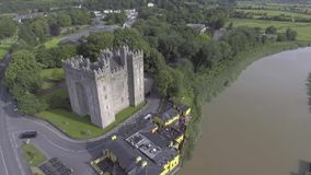 Aerial view of Ireland's most famous public Castle. Bunratty Castle, County Clare, Ireland stock video footage
