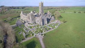 Aerial view of an Irish public free tourist landmark, Quin Abbey, County clare, Ireland. Aerial landscape view from Ireland stock footage