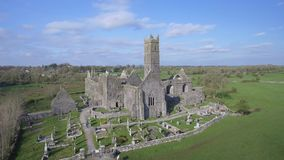 Aerial view of an Irish public free tourist landmark, Quin Abbey, County clare, Ireland. Aerial landscape view from Ireland stock video footage