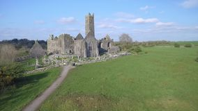 Aerial view of an Irish public free tourist landmark, Quin Abbey, County clare, Ireland. Aerial landscape view from Ireland stock video
