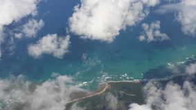 Aerial view of island clouds sea sky Stock Images