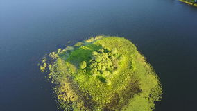 Aerial View of Island in Freshwater Lake on Cape Cod, MA. Aerial view of the peaceful, summer scenery in a freshwater lake on Cape Cod, Massachusetts. This stock footage