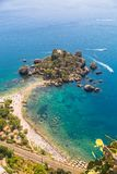 Aerial view of island and Isola Bella beach and blue ocean water royalty free stock image