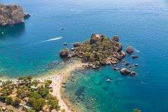 Aerial view of island and Isola Bella beach and blue ocean water stock photos