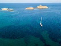 Aerial view of the islands of Finocchiarola, Mezzana, A Terra, Peninsula of Cap Corse, Corsica, France. Tyrrhenian Sea. Sailboats. Aerial view of the islands of royalty free stock photo