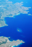 Aerial view of islands. Aerial view of Komodo islands, Indonesia, surrounded by deep blue waters Stock Images
