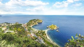 Isola Bella island and beach in Taormina, Sicily, Italy. Aerial view of Isola Bella island and beach in Taormina, Sicily, Italy. Giardini-Naxos bay, Ionian sea stock video footage