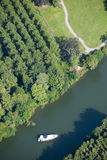 Aerial view : isolated boat on a river Stock Photos