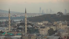 Aerial view of Istanbul city Turkey, Rustem Pasha Mosque at Eminonu on a cloudy sky, day time with sunny weather. Slow stock footage
