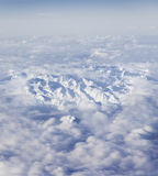 Aerial view of Italian Alps. Aerial view of snow capped peaks of Italian Alps covered by cloudscape stock photos