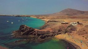 Aerial view of the jagged shores and beaches of Lanzarote, Spain, Canary. Roads and dirt paths. Papagayo beach. Aerial view of the jagged shores and beaches of stock video