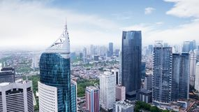 Aerial view of Jakarta cityscape. JAKARTA, Indonesia. January 27, 2018: Aerial view of Jakarta skyscrapers in Sudirman Central Business District shot from a royalty free stock photo