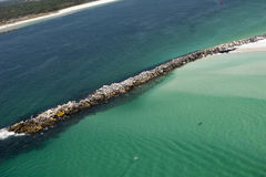 Aerial view of jetty along the coastline of Panama City, Florida stock photo