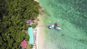 Aerial view jetty and boat in the Manukan Island of borneo. Aerial view from jetty and boat in the Manukan Island of borneo stock video footage
