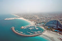 Aerial View of Jumeirah Beach Hotel. Aerial view of the Jumeirah Beach Hotel and Marina from the Burj al Arab Royalty Free Stock Photo