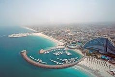 Aerial View of Jumeirah Beach Hotel. Aerial view of the Jumeirah Beach Hotel and Marina from the Burj al Arab royalty free stock photo