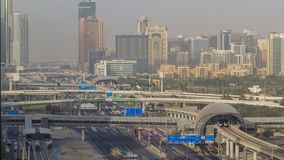 Aerial view of Jumeirah lakes towers skyscrapers and Al Barsha district timelapse with traffic on sheikh zayed road. Aerial view of Jumeirah lakes towers stock footage