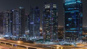 Aerial view of Jumeirah lakes towers skyscrapers night timelapse with traffic on sheikh zayed road. Aerial view of Jumeirah lakes towers with illuminated stock video