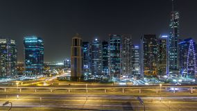 Aerial view of Jumeirah lakes towers skyscrapers night timelapse with traffic on sheikh zayed road. Aerial view of Jumeirah lakes towers with illuminated stock footage