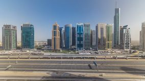 Aerial view of Jumeirah lakes towers skyscrapers timelapse with traffic on sheikh zayed road. Aerial view of Jumeirah lakes towers skyscrapers during all day stock video