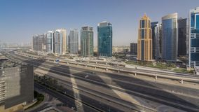 Aerial view of Jumeirah lakes towers skyscrapers timelapse with traffic on sheikh zayed road. Aerial view of Jumeirah lakes towers skyscrapers timelapse with stock video footage