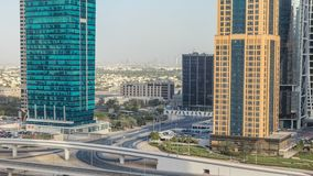 Aerial view of Jumeirah lakes towers skyscrapers timelapse with traffic on sheikh zayed road. Aerial view of Jumeirah lakes towers skyscrapers timelapse with stock footage