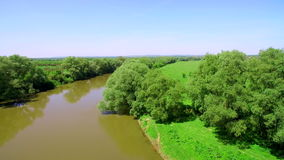Aerial View 4k. Flying over the beautiful River. Aerial camera shot. Landscape panorama. stock footage