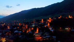 Aerial view of Svan towers in Mestia at night stock video footage