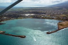 Aerial view of Kahului Harbor beside the town of Kahului on Maui`s eastern coast. Aerial view of Kahului Harbor on the east coast of Maui, Hawaii, with the royalty free stock photo