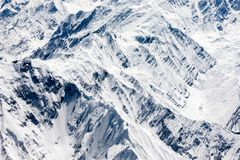 Aerial view of Karakoram or Karakorum mountains. Spanning the borders of Pakistan, India, and China royalty free stock photo